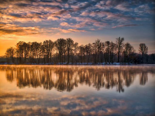 sunrise with fog on the lake