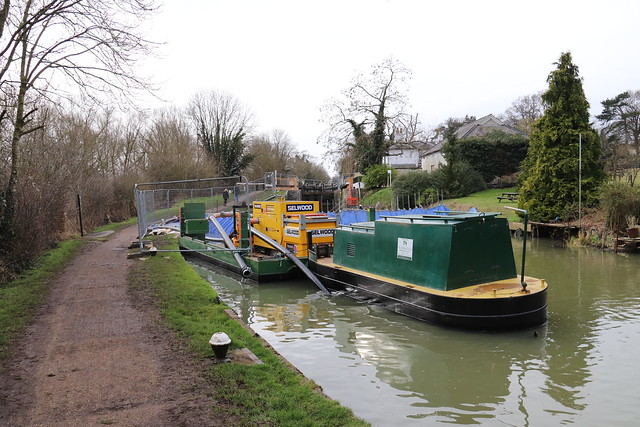 Tug & Barge Laden With Pumps