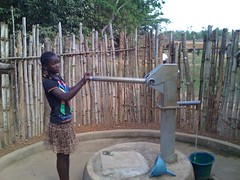 Girl collecting water from a new well, Bong County, Liberia