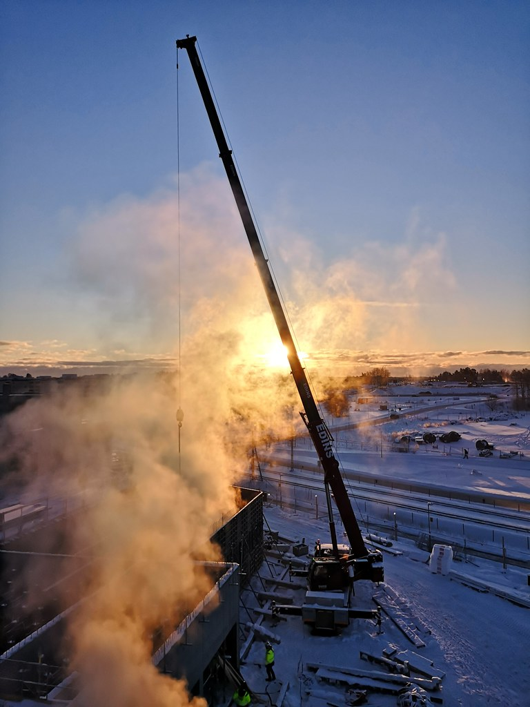 Sunrise, crane and steam
