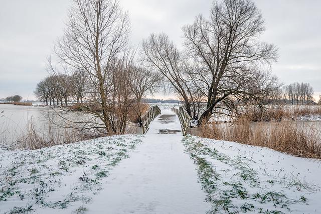 Wooden bridge in a snowy landscape