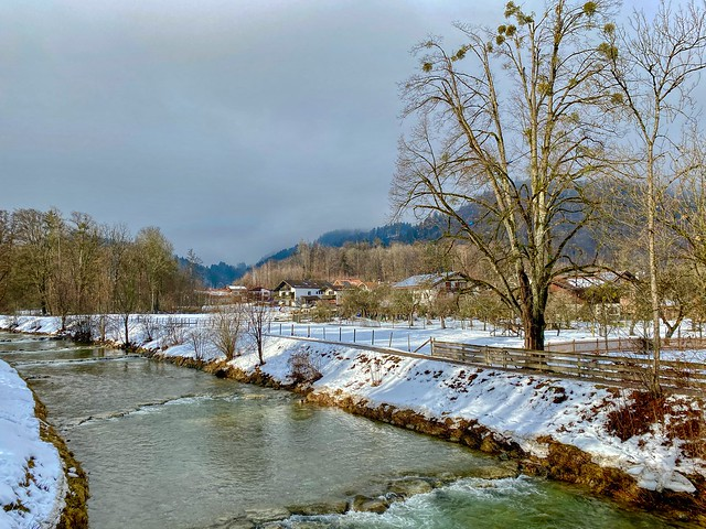 Auerbach creek in winter passing Reisach in Bavaria, Germany