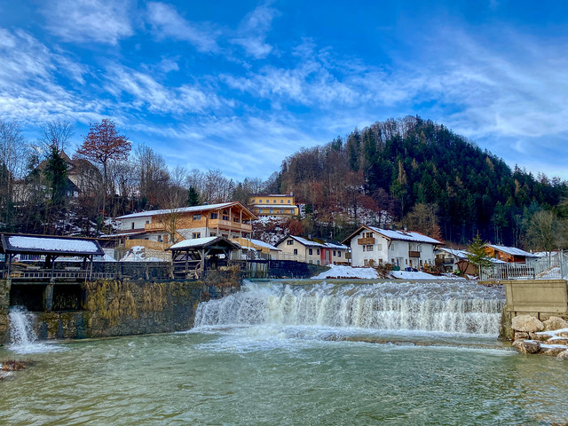 Kieferbach creek with cascade in winter in Kiefersfelden in Bavaria, Germany