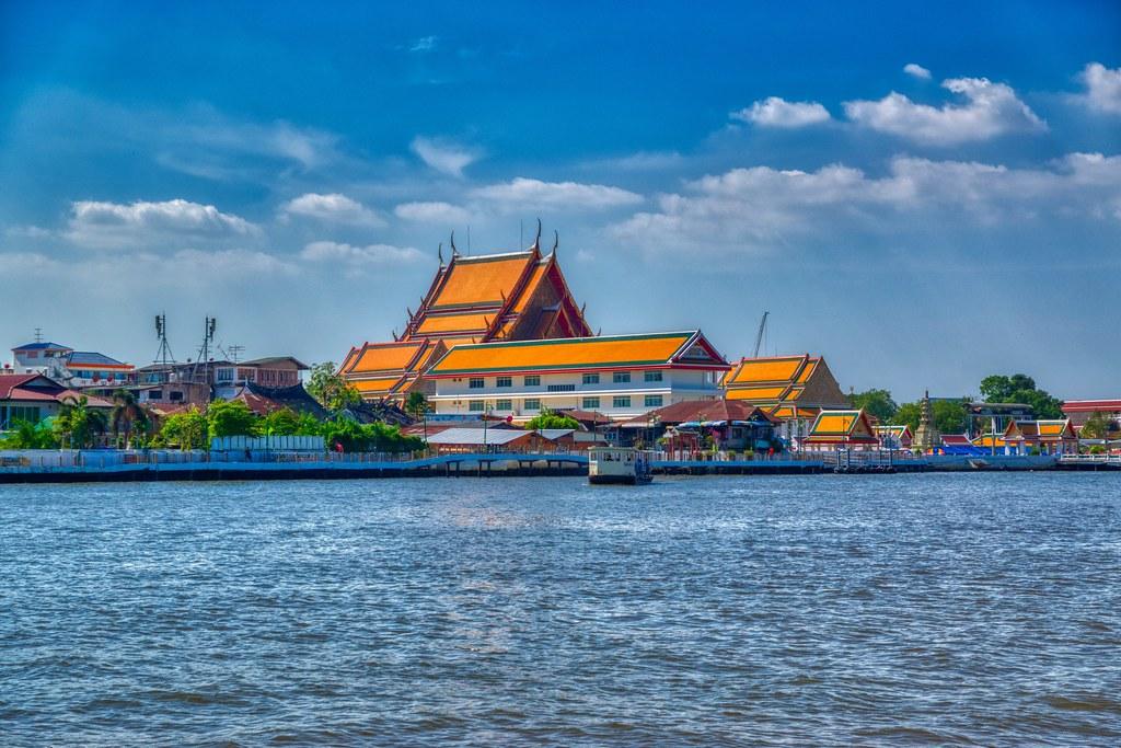 Wat Kanlayanamit Woramahawihan by the Chao Phraya river in Bangkok, Thailand