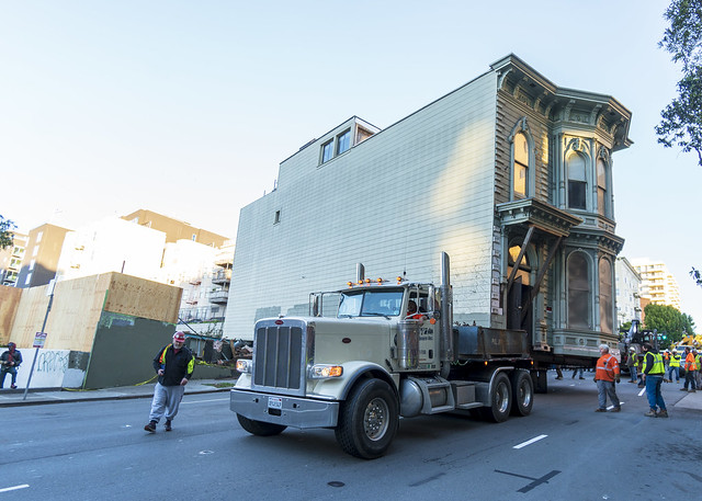 Truck Makes the First Turn With Victorian House