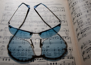 Blue sun glasses refraction music book | by Ray Duffill