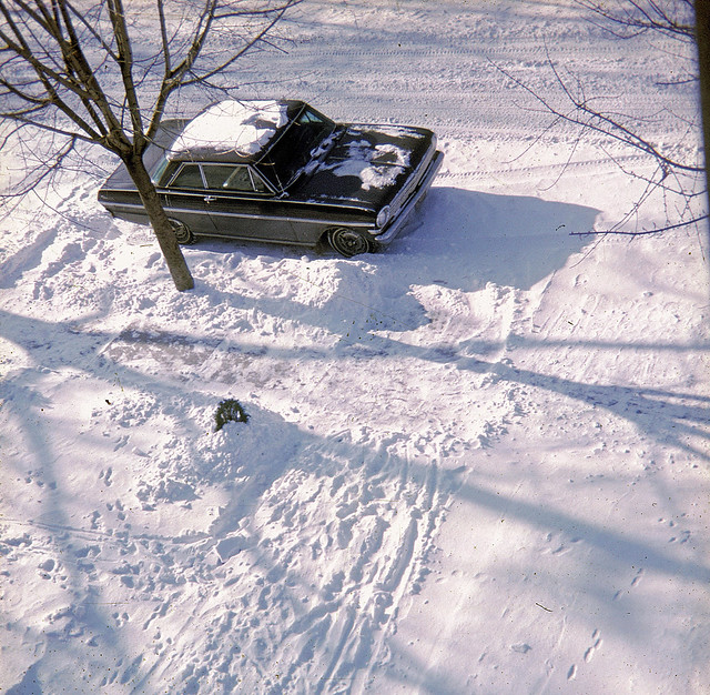 Snow, Snow and MORE snow! This is starting to get really old. One of the snowiest winters in recent memory. Our neighbor's new Chevy Nova SS parked in... well, snow!  Taken from my room. Milford, Connecticut. Jan 1968