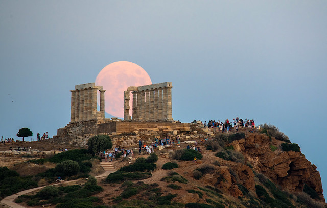 moon rising behind the ancient temple