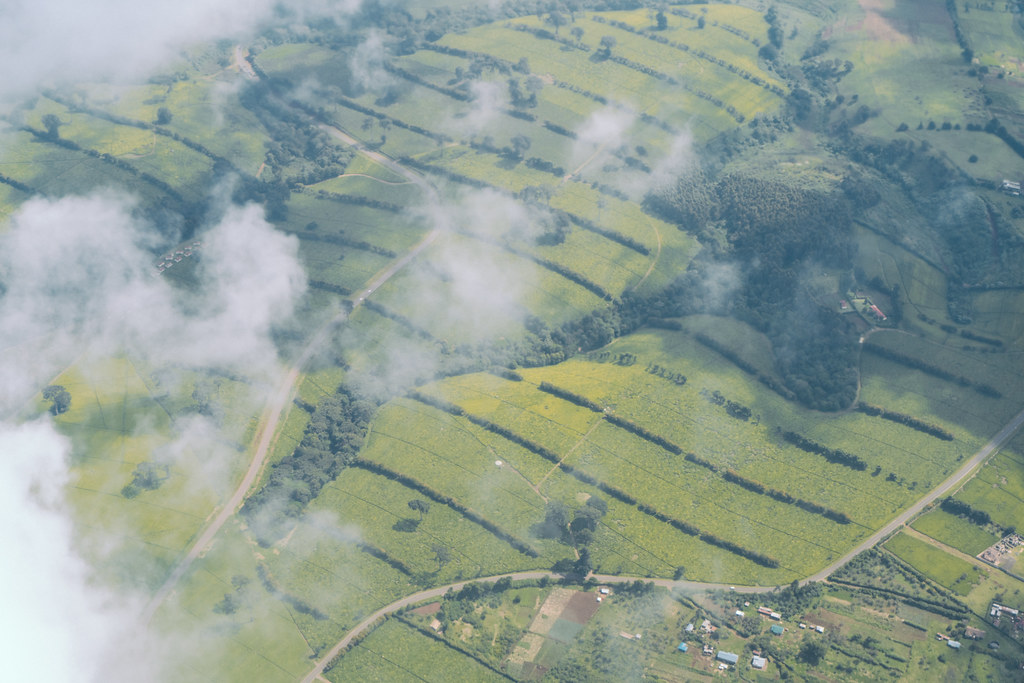 Wispy clouds over green hills in East Africa.