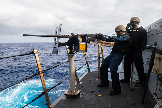 PHILIPPINE SEA (Feb. 20, 2021) Cryptologic Technician (Technical) 2nd Class Gabriel Lorico, left, from Sacramento, Calif., and Aviation Boatswain's Mate (Fuels) 3rd Class Alapati Tautai, from Nu'uuli, American Samoa, fire a 50-cal machine gun during a live-fire gunnery training exercise aboard amphibious transport dock ship USS New Orleans (LPD 18). New Orleans, part of the America Expeditionary Strike Group, along with the 31st Marine Expeditionary Unit, is operating in the U.S. 7th Fleet area of responsibility to enhance interoperability with allies and partners and serve as a ready response force to defend peace and stability in the Indo-Pacific region. (U.S. Navy photo by Mass Communication Specialist 2nd Class Kelby Sanders)