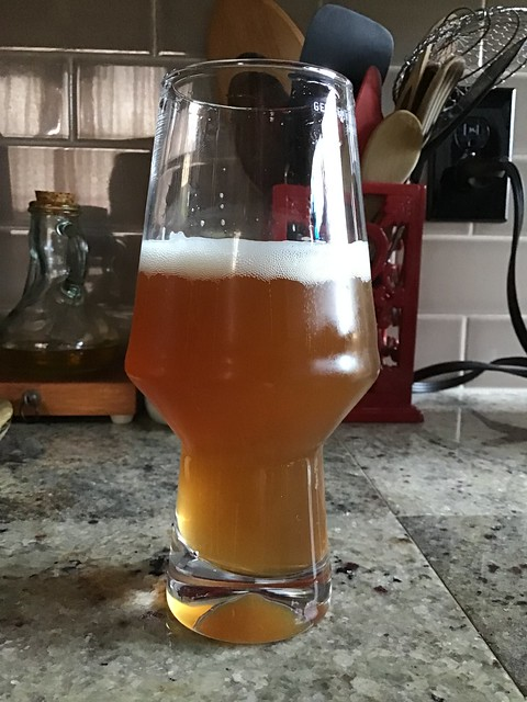 Pale ale in glass on countertop