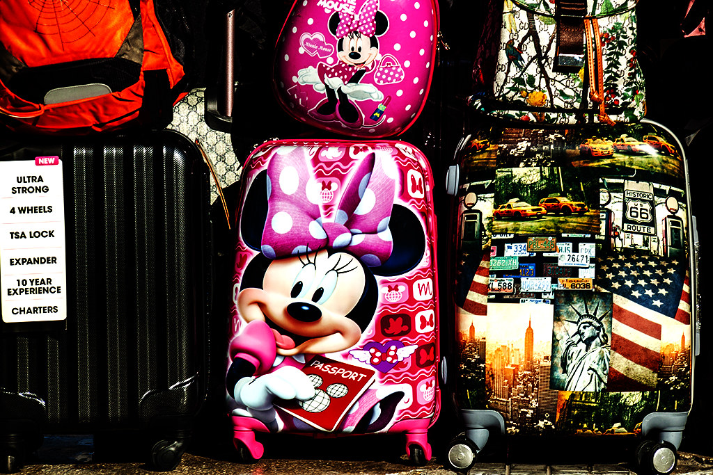 Minnie Mouse, Statue of Liberty and Route 66 on suitcases--Tirana