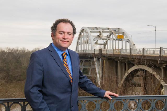 Keith Hébert stands in front of the Edmund Pettus Bridge in Selma, Alabama.