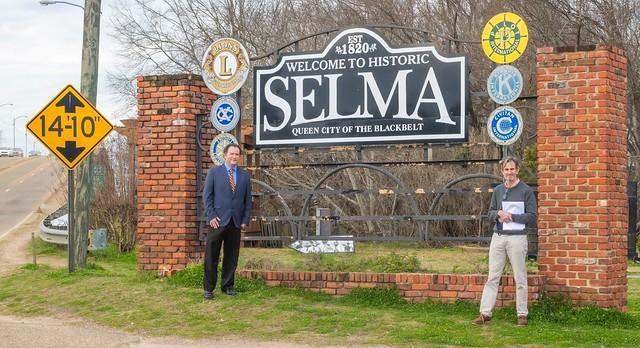 Richard Burt and Keith Hébert in front of the Edmund Pettus Bridge in Selma, Alabama.