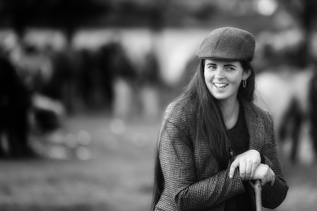 Smiling lady with a tweed cap