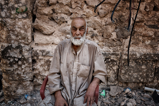 Battle of Mosul. This old man could not walk anymore and was waiting for some help in the middle of the battle field.