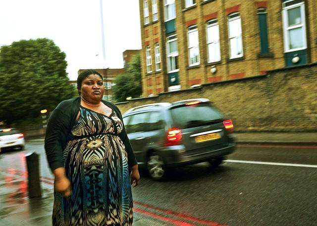 Woman walking, Homerton High Street, 2017