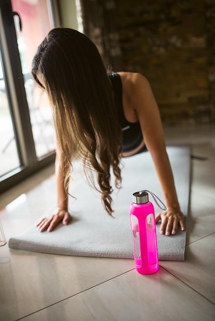Woman doing push ups on a yoga mat.