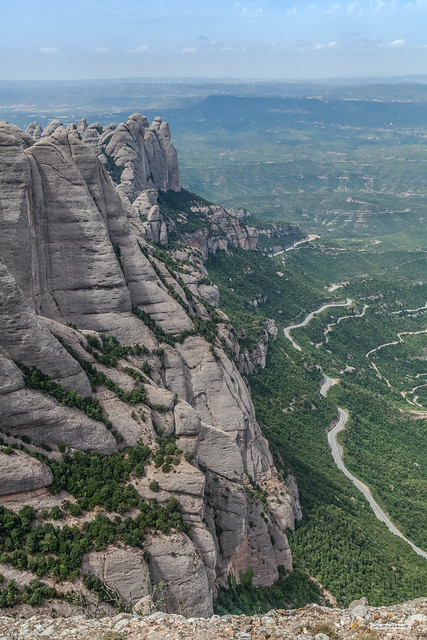 From the summit of Sant Jeroni, 1,236 metres. Wooded foothills, rocky summits of Montserrat, Catalonia, Spain.