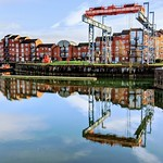 Reflections of the boat crane at Preston Docks