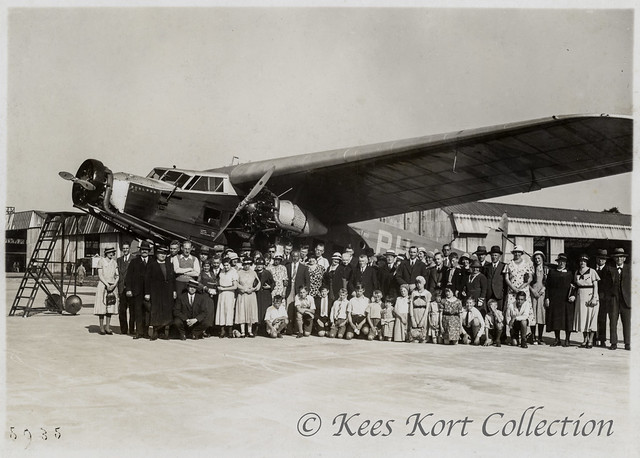 A large visiting group for an airfield posing for the big Fokker F.IX 'Adelaar' [Eagle] trimotor civil airliner  during the first half of the 1930's [Netherlands, 1929]