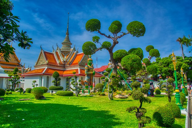 Small park at Wat Arun, the Temple of Dawn, by the Chao Phraya river in Bangkok, Thailand