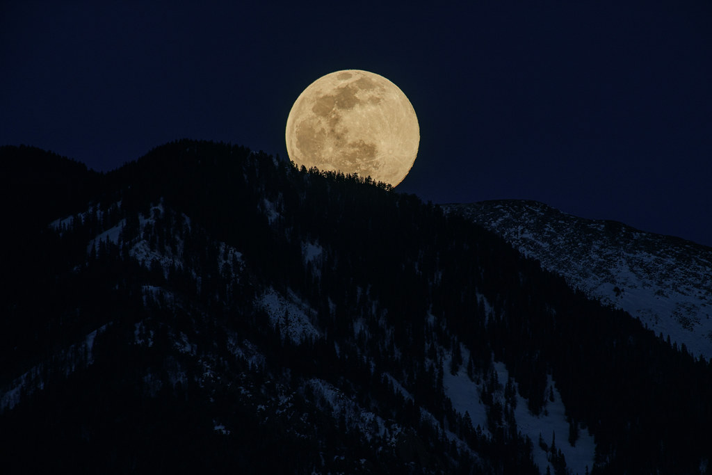 """February's """"Snow Moon"""" Rising Over Taos Mountain"""