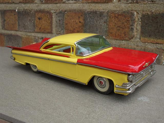Vintage Tinplate Red & Yellow Cragstan 1959 Buick  Le Sabre Two Door Hardtop Made in Japan