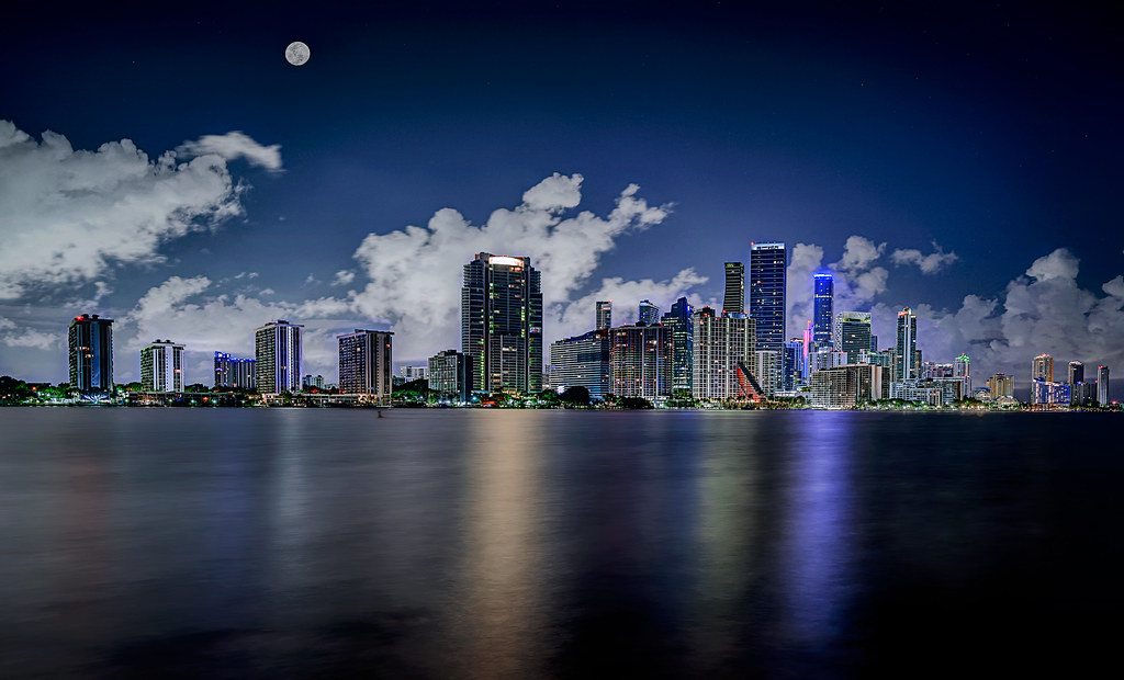 Moon over Miami.  View of moon and Miami skyline from the Rickenbacker Causeway, Miami, Florida.