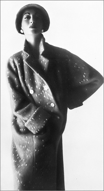 Della Oake in easy topcoat of deep-piled wool, sand dappled with white and double-breasted fastening by Ian Meredith, hat by Harvane, photo by Keith Ewart, Harper's Bazaar UK, October 1953