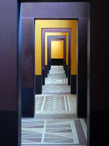 Richly coloured hallway with doors leading through the Museum