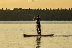 Enjoying a standing board at sunset, Waskesiu Lake, Prince Albert National Park, Sask