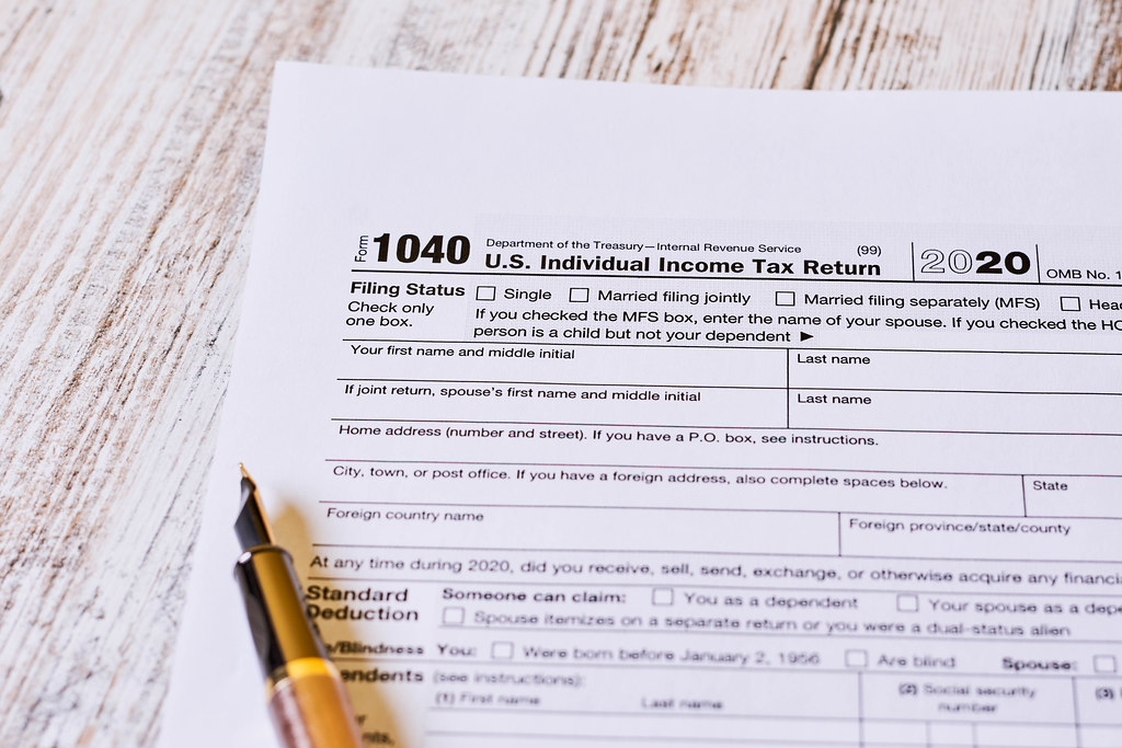 Tax time - Close-up shot of U.S. 1040 tax return form with pen