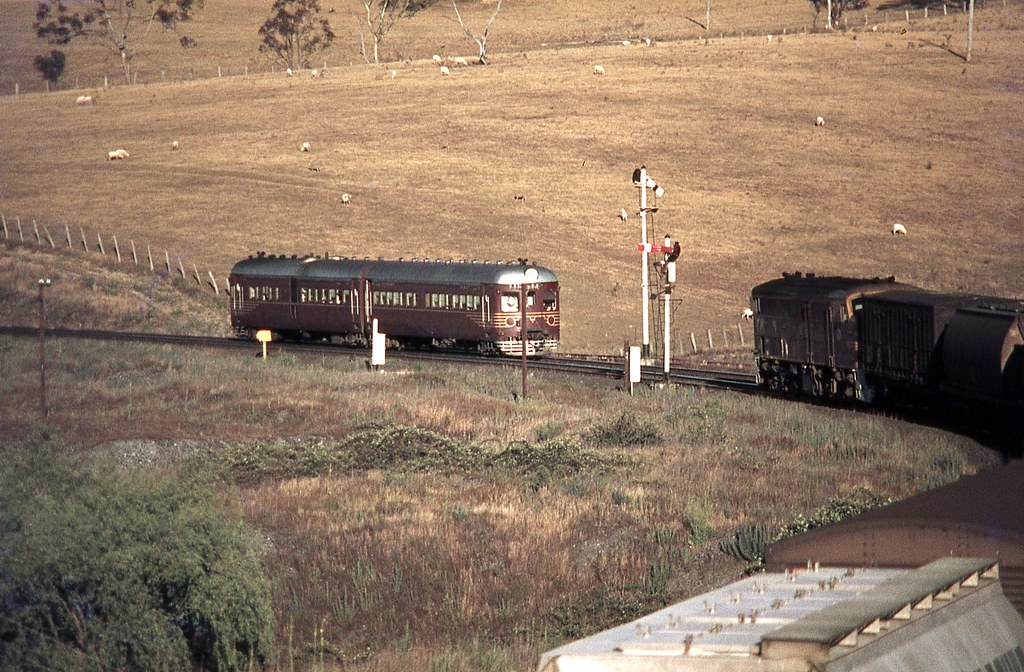 734/634 Westbound crossing 44aa Eastbound Freight, Tarana, NSW by dunedoo