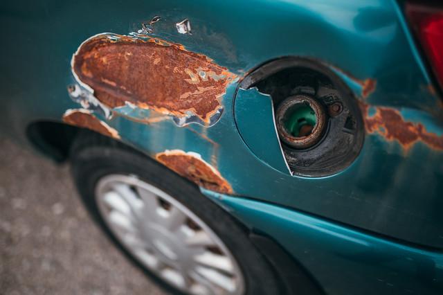 Close-up of the broken fuel tank cap on a car