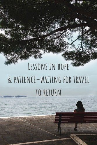 Woman sitting on a bench under a tree, looking out at the water. From Through the Eyes of an Educator: Lessons in hope & patience–waiting for travel to return