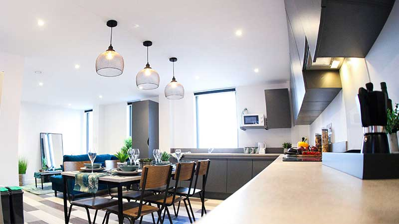 Kitchen, living and dining room in an Aquila Court townhouse