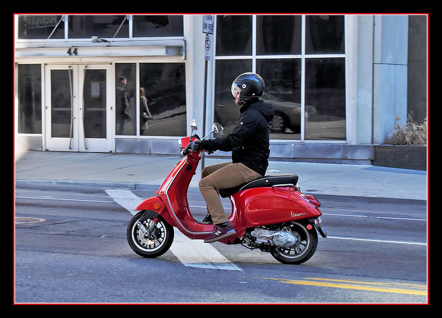 Touring Detroit, Michigan on His Vespa