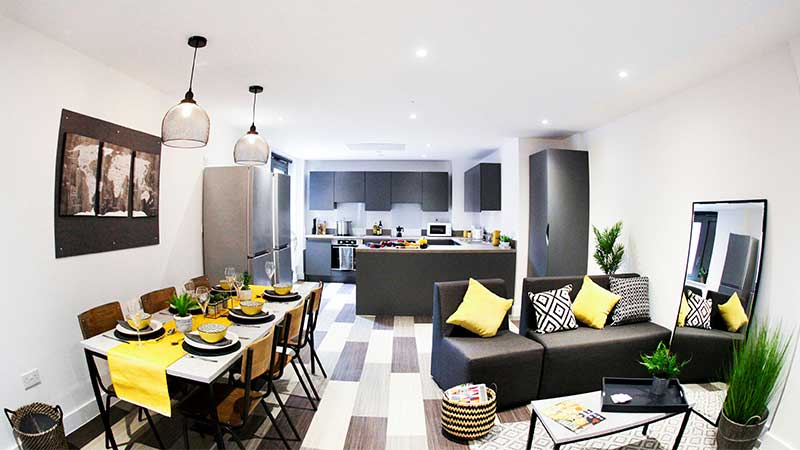 A kitchen, dining and living room area in Aquila Court.