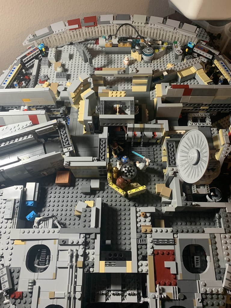 My extremely MODed UCS Millennium Falcon. The structure is no longer the same at all. Unfortunately I don't have enough light tan pieces to make it look good at the moment. I am making the elevator from episode five (ie gaping hole in hallway).