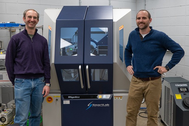 Ryan Comes and Byron Farnum stand in front of X-ray equipment
