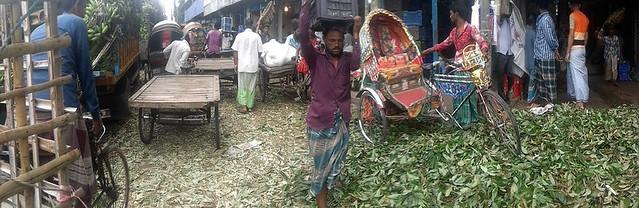 Dhaka- pedicab stalled on mound of peel at wholesale fruit market, 2019