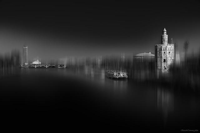 Two towers on an illuminated shore - Dos torres en una orilla iluminada