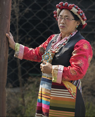 Woman dressed in traditional U-tsang choegha costume. U-tsang is one of the three provinces of Tibet that covers mostly the central and western parts of Tibet.