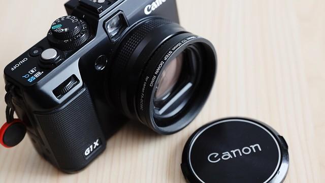 PowerShot G1X + Canon vintage lens cap.