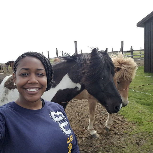 Author Brielle Wright in front of horses