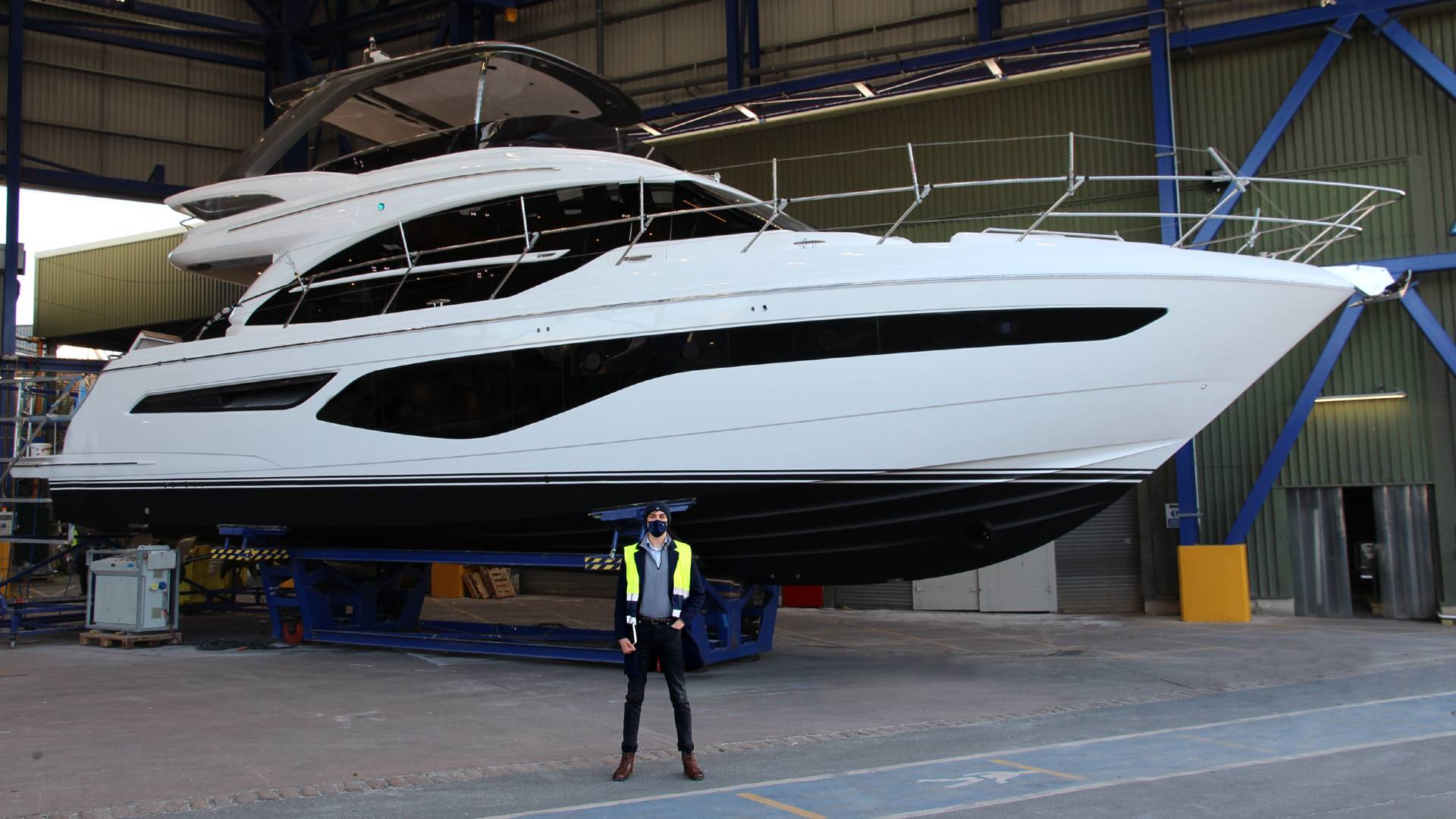 Toby Thwaites stood in front of a yacht