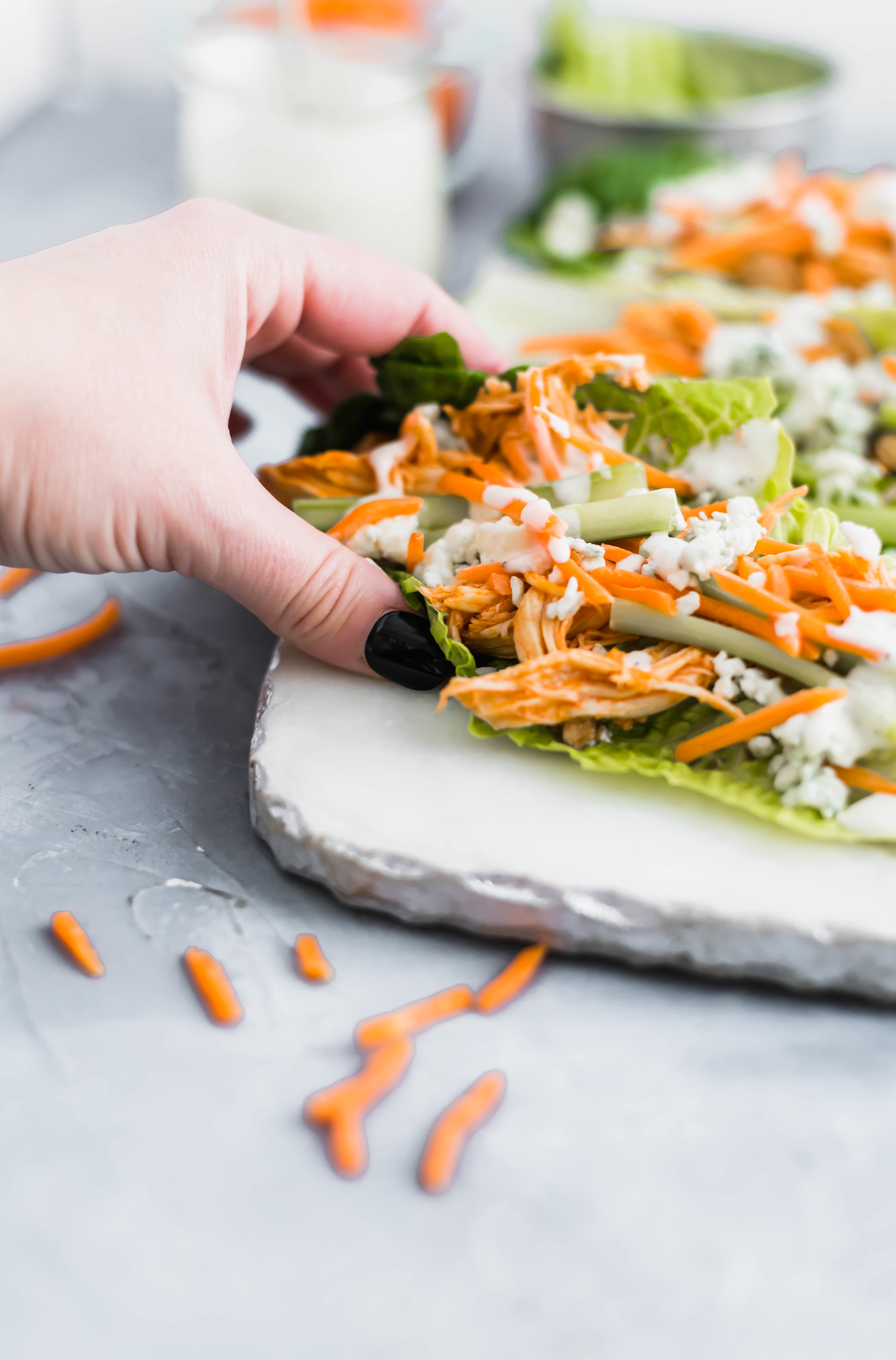 Buffalo Chicken Lettuce Wraps make for an easy, healthy and delicious meal. The buffalo chicken cooks in the slow cooker to make this super simple.
