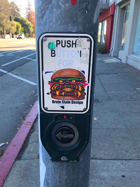 Sticker art on cross-walk burtton