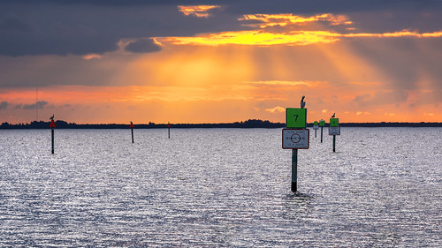 stephenfrazier photography poncedeleon historical park markers channel boats fowl pelicans ripples puntagorda florida fl boating sunset sundown evening beams rays light streaming golden orange clouds water
